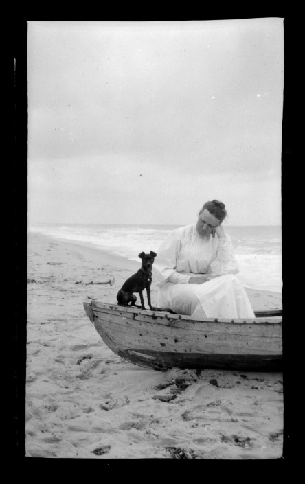 Woman and dog in boat, Sea Girt Marriott C. Morris Collection [P.2013.13.142]