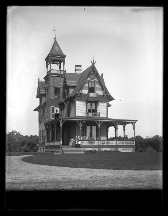 Marriott C. Morris, [Front view of Avocado with two women sitting on the porch, Sea Girt, NJ], ca. 1900.